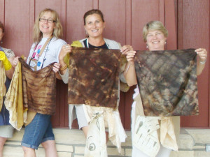 Natural dyeing with willow on silk by students in workshop with Donna Kallner.