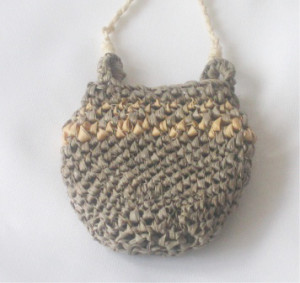 Basswood bark fiber pouch worked in Burundi looping by Donna Kallner.