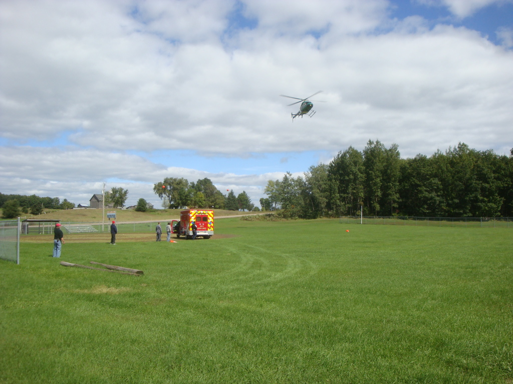 Volunteer fire departments set up landing zones for medical helicopters.