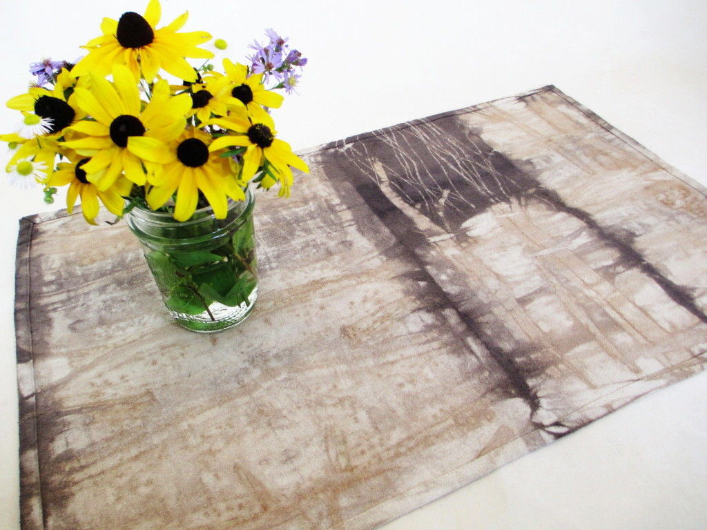 Bark-dyed table topper by Donna Kallner.