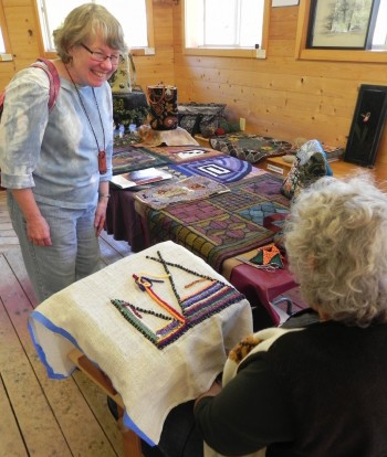 Donna Kallner visits with rug hooker Betty Heath at The Gathering at Sievers 2014.