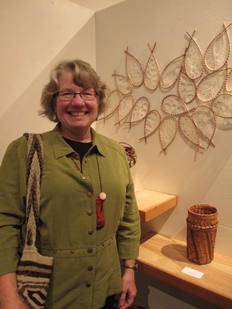 "Donna Kallner at All Things Considered VIII basketry exhibition with ""Shoal""."