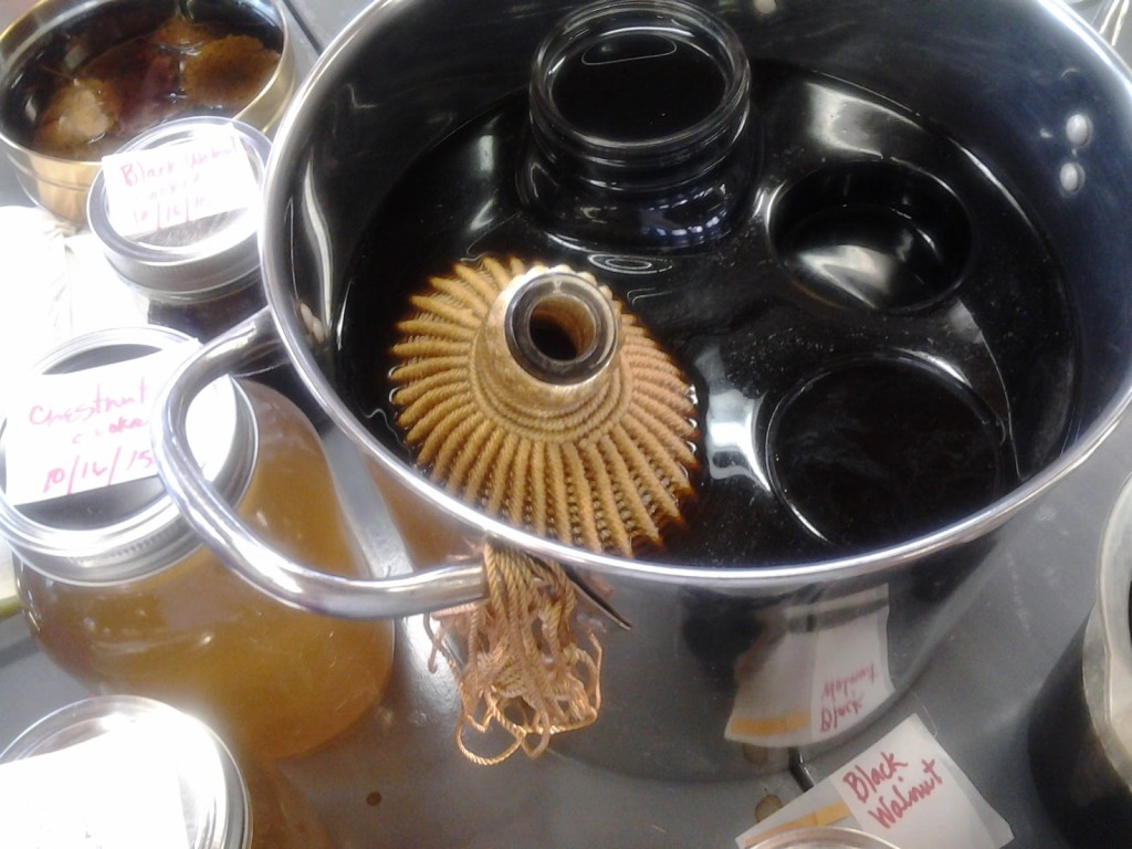 Macrame-covered wine bottle got a new look from walnut hull dye.