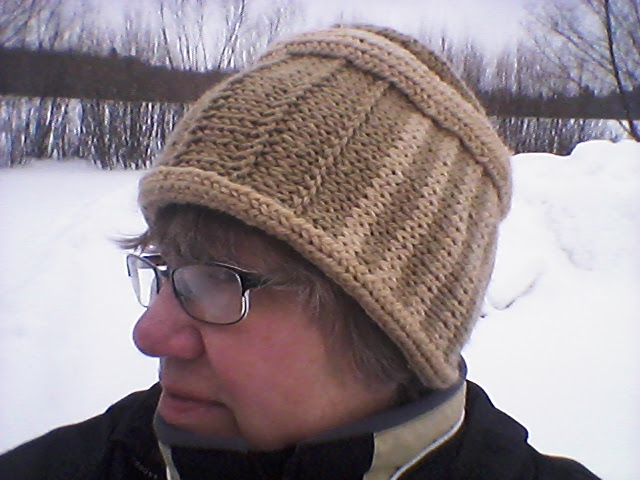 Hat combines knitting with cross-knit looping and nalbinding.
