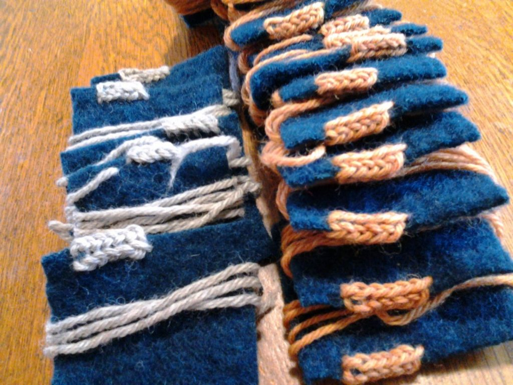 Cross-knit looping student samplers