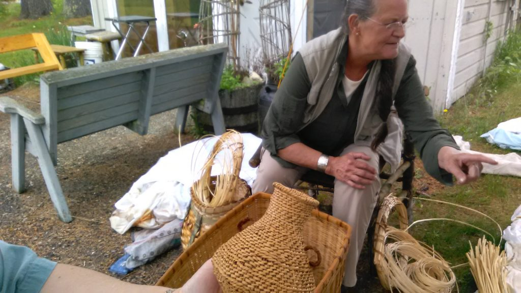 Dawn Walden with samples of willow skein baskets.