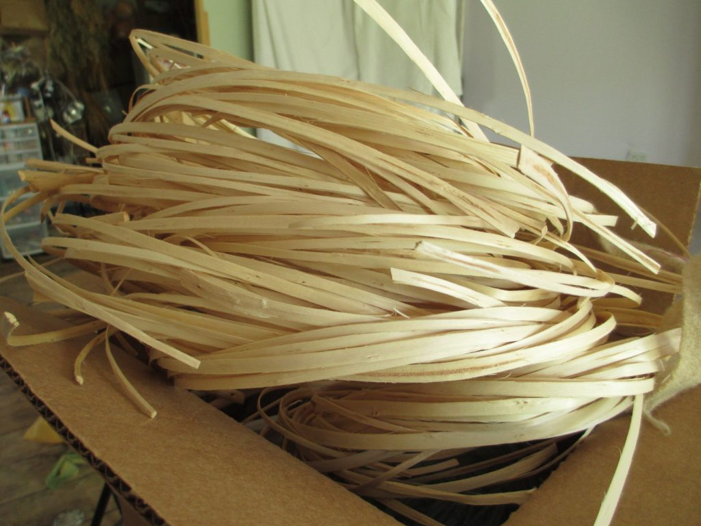 Willow bundles with backs off ready for the next step in the skeining process.