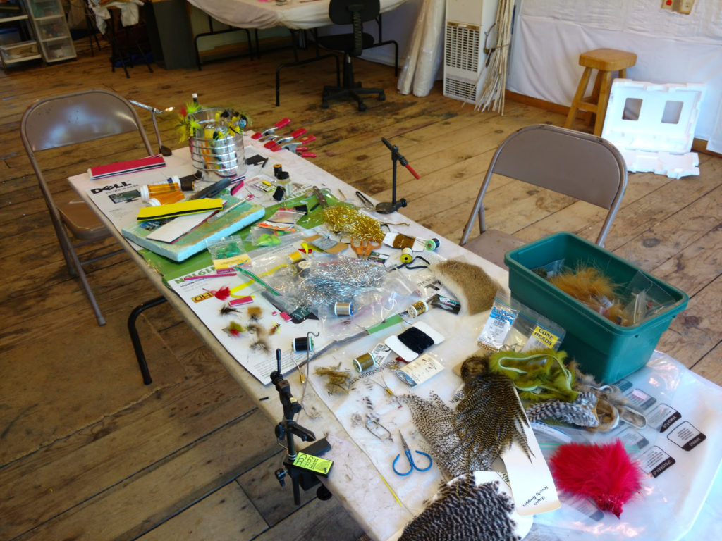 Fly tying table at fishing camp.