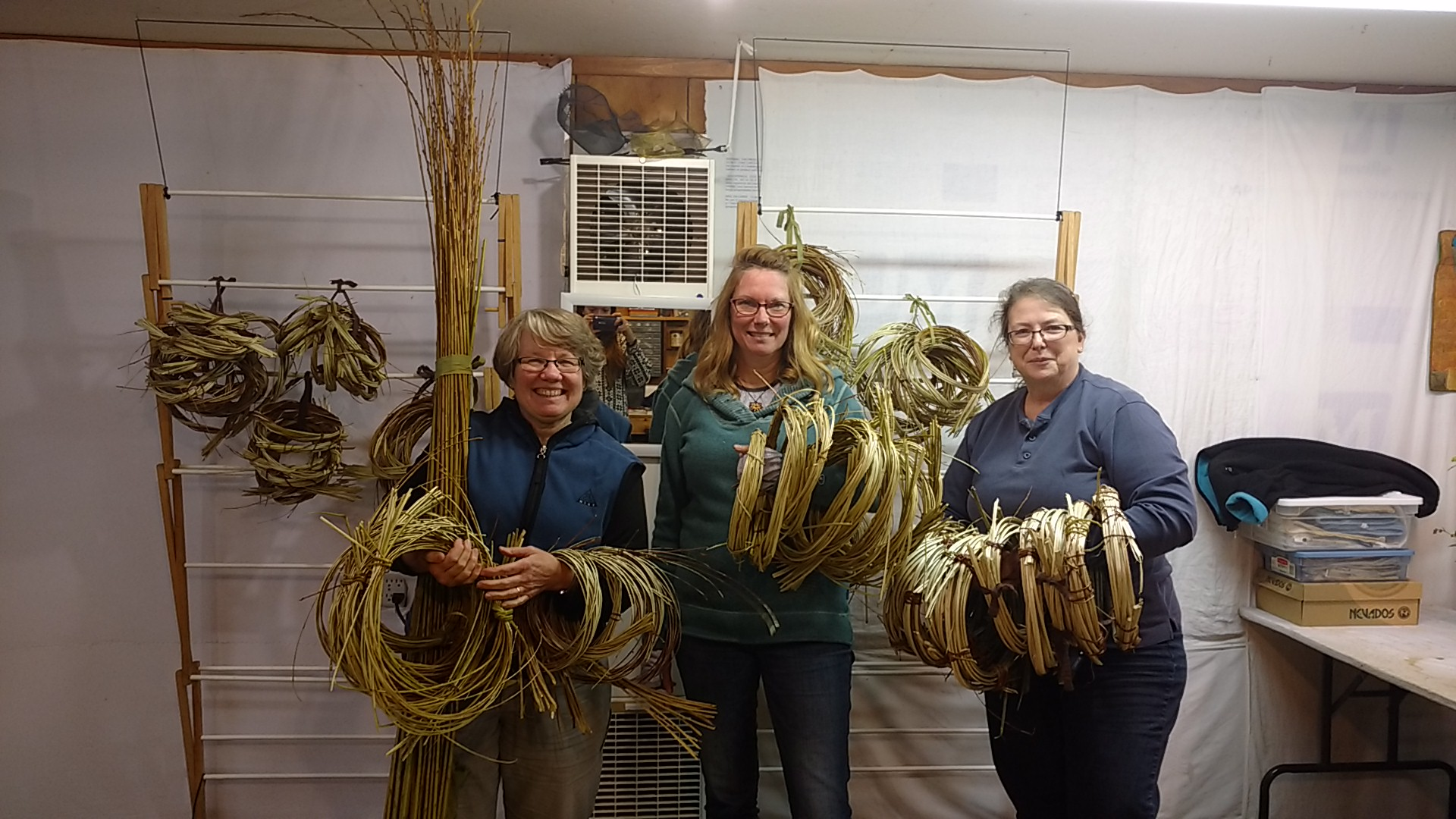 Donna Kallner, Karen Tembreull and Poppy Hatinger with some of the cleaved willow from the 2016 harvest.